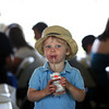 Manchester: With a face covered in blueberries and strawberries Gavin Golomb, 2, ejoys his chocolate milk at the annual Red, White and Blue Breakfast held at Tuck's Point Saturday moning. The menu included bacon, eggs, and pancakes with blueberries, strawberries and whipped cream. Mary Muckenhoupt/Gloucester Daily Times