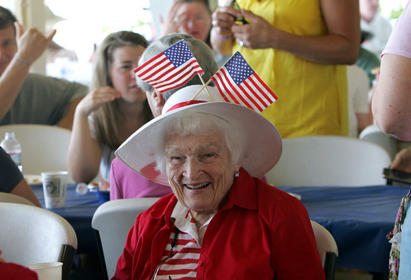 "Manchester: Sally Loring wears a very patriotic hat at the annual Red, White and Blue Breakfast held at Tuck's Point Saturday moning.  Loring is the wife of George ""Gid"" Loring who was palying music at the breakfast with his band Gid's Giddy Gang. Mary Muckenhoupt/Gloucester Daily Times"