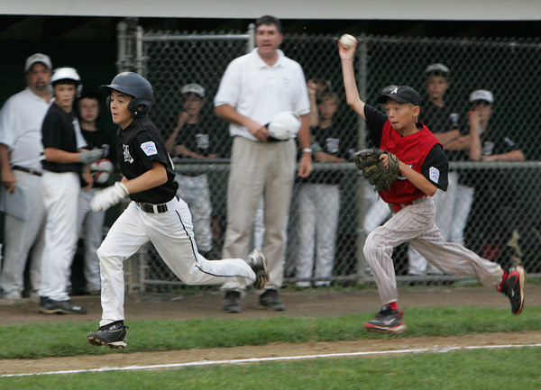 Gloucester: Amesbury third baseman Levi Burrill chases down Beverly's Christian Miller in a rundown which lead to Miller being called out during the District 15 Little League all-star baseball game at Boudreau Field in Gloucester Wednesday night. Mary Muckenhoupt/Gloucester Daily Times