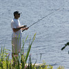 Gloucester: Andy Capener patiently waits for a bite while fishing at Centennial Grove Saturday afternoon. Capener said he wasn't catching any fish and his son was having better luck with his fishing net. Mary Muckenhoupt/Gloucester Daily Times