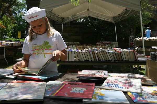 Manchester: Hannah Klim, 10, flips through a book at the Manchester Public Library's Book Sale on Sunday. The sale brought over 1,000 people to the library over the weekend. Photo by Kate Glass/Gloucester Daily Times