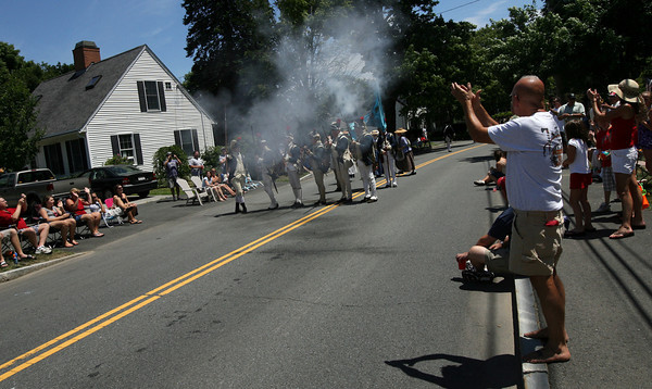 Manchester: The crowd applauds as the Revolutionary soldiers fire their weapons during the Manchester 4th of July Parade yesterday afternoon. Photo by Kate Glass/Gloucester Daily Times