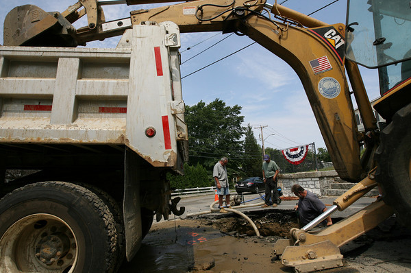 Gloucester: Gloucester DPW employees Dave McPhail, Leo Amero, and Mark Eastman, repair a water main break in front of the Bayview Fire Station yesterday morning. Photo by Kate Glass/Gloucester Daily Times