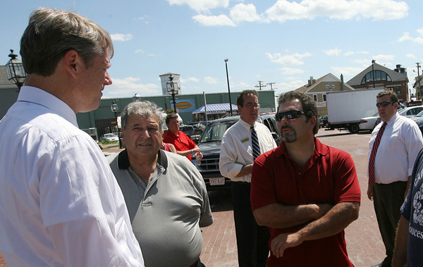 Gloucester: Charlie Baker, republican candidate for governor, talks with Vito Calomo and Al Cottone at St. Peter's Square about how the fishing regulations are forcing them out of work. Photo by Kate Glass/Gloucester Daily Times