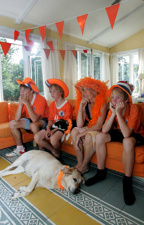 Rockport: The Roell family, from left, Shaffy, 16, left, Gideon, 11, mom Skaskia and Sam, 14, look discouraged as Spain wins in the Germany vs. Spain world cup soccer game in their Rockport home Wednesday afternoon. The Roells, who are from the Netherlands, were waiting to see who would win this game because the winner plays the Netherlands on Sunday and thought Germany would be an easier team to beat. Mary Muckenhoupt/Gloucester Daily Times