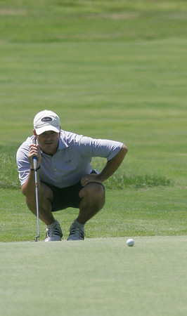 Gloucester: Ed Young lines up a putt during the Bass Rocks Golf Club Championship yesterday. Photo by Kate Glass/Gloucester Daily Times