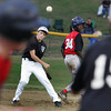 Gloucester: Beverly's Jordan Rawding throws the ball to first after getting Amesbury's Sulai Guilbault out at second during the District 15 Little League all-star baseball game at Stage Fort Park in Gloucester Wednesday night. Mary Muckenhoupt/Gloucester Daily Times