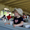 Manchester: Penelope Riggs, 2, sways to the music while listening to Gid's Giddy Gang at the annual Red, White and Blue Breakfast held at Tuck's Point Saturday moning. The menu included bacon, eggs, and pancakes with blueberries, strawberries and whipped cream. Mary Muckenhoupt/Gloucester Daily Times