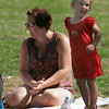 "Rockport: Kayleigh Greene, 2 1/2, dances while she and her mom, Ann Greene, listen to David Bates sing ""Bingo"" during ""Earth Rhythms: Stories and Songs for the Whole Earth"" at Millbrook Meadow yesterday afternoon. The program was sponsored by the Friends of the Rockport Library. Photo by Kate Glass/Gloucester Daily Times"