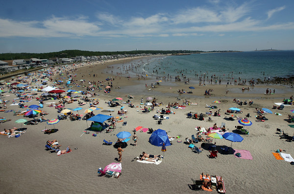 Gloucester: Long Beach, as seen from the Cape Ann Motor Inn, was crowded yesterday afternoon partly because the Good Harbor Beach parking lot was closed to the general public. Photo by Kate Glass/Gloucester Daily Times