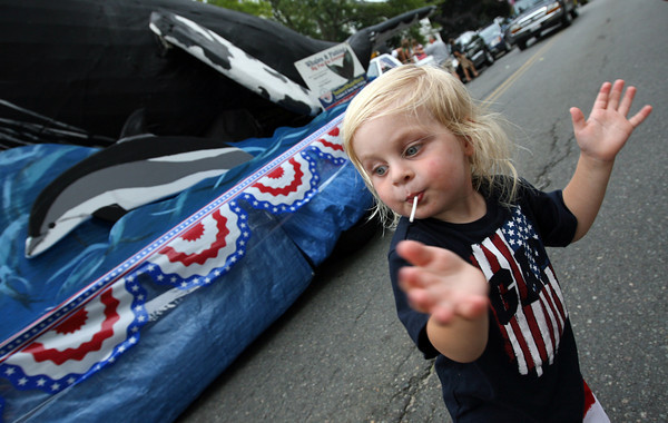 Rockport: Sean Adam Baskett, 2, dances to the music during the Rockport Firemen's Parade yesterday. Photo by Kate Glass/Gloucester Daily Times