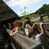 Essex: Christopher Batten, 7, Gianna Randazzo, 6, and Grace Gardella, 5, try to cross the bridge at the Essex Elementary School playground without touching the bottom. Photo by Kate Glass/Gloucester Daily Times