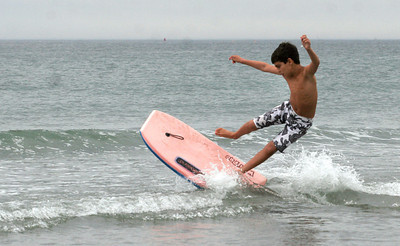 Rockport: Luke Nascimento, 9, gets some air while riding his boogie board through the surf at Cape Hedge Beach yesterday afternoon. Photo by Kate Glass/Gloucester Daily Times