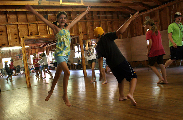 Rockport: Meagan Smith leaps through the air during a dance class taught by Ann-Marie Hauck at the Art Harbor Camp at Windhover. The camp offers acting, dance, and art classes. Photo by Kate Glass/Gloucester Daily Times