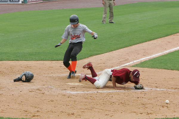 Lowell: Gloucester pitcher Kyle Lucido tries to get the ball to home plate as Oford's Ryan Deviney scores a run during the State Senior Little League Finals at LaLacheur Park in Lowell Saturday afternoon. In the best two out of three tournamnet Gloucester lost both games to Oxford. Mary Muckenhoupt/Gloucester Daily Times