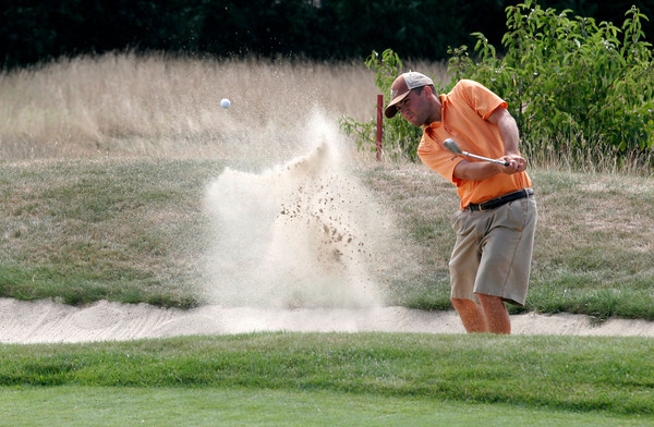 Gloucester: Josh Salah hits out of the sand trap during the Bass Rocks Golf Club Championship yesterday. Photo by Kate Glass/Gloucester Daily Times