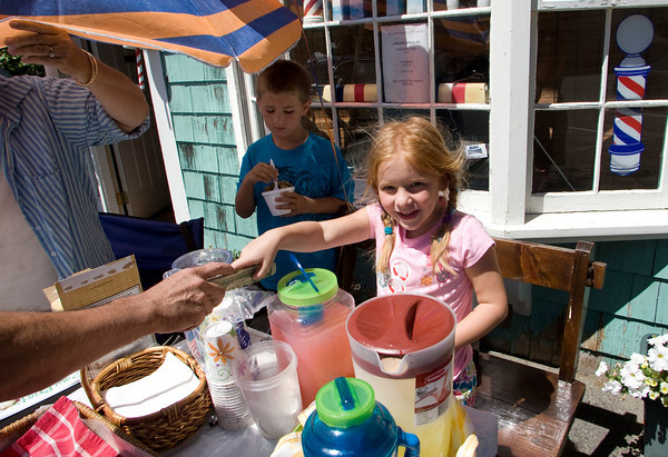 Rockport: Sarah Vanderpool, 6, sells a glass of lemonade to raise money for the Cape Ann Animal Aid at the Whistlestop Mall with her brother Dillon, 8, Saturday morning.  Sarah and Dillon had raised $140 so far selling pink and yellow lemonade, cookies and handmade bracelets, and were hoping to beat the amount they raised last year of $220. Mary Muckenhoupt/Gloucester Daily Times