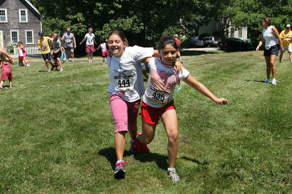 Gloucester Taylor Abbott, 10, left and her friend Isabella Prendergast, 10, are first to cross the finish line of the three legged race at the LEAP, Lanesville Emergency Action Program, 2010 Extravaganza at the Lanesville Community House Saturday.  The day included a 4K race, one mile frun run, and food, and family games. Mary Muckenhoupt/Gloucester Daily Times