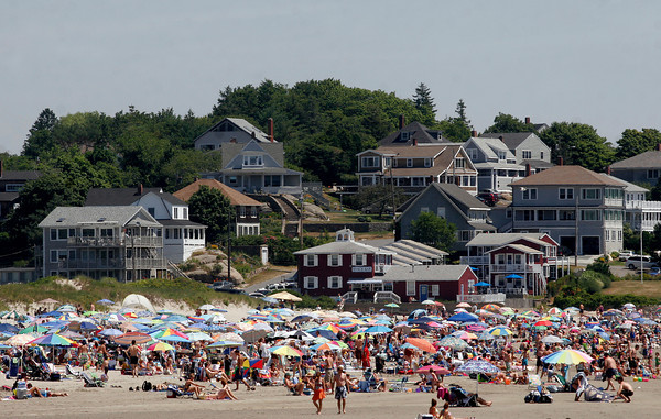 Gloucester: Good Harbor beach was packed yesterday afternoon as people sought relief from the heat. The parking lot was restricted to residents only from roughly 10-2 throughout the weekend due to the crowds. Photo by Kate Glass/Gloucester Daily Times