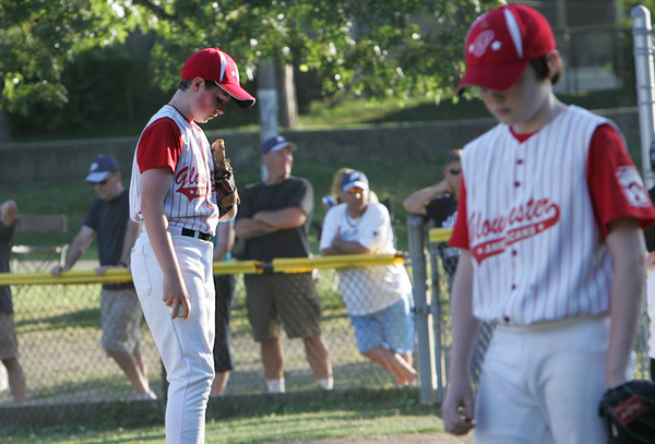 Salem: Pitcher Kyle Mailey and third baseman Ryan Harrigan hang their heads while Beverly celebrates their 9th run as the Gloucester Americans vs. Beverly East in the Williamsport Little League tournament at Forest River Park in Salem Friday night. Mary Muckenhoupt/Gloucester Daily Times