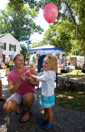 Gloucester: Katie Bingham, 3, takes a pink ballon from her mom at the Annisquam Village Seafair Saturday morning. Katie got a pink ballon for herself and a red balloon for her brother. Mary Muckenhoupt/Gloucester Daily Times