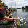 "Gloucester: Fulton Randge-Cunha sets his remote operated vehicle, the ""SS Epic"" into the water behind the Gloucester Maritime Heritage Center as Hailey Muniz and Kerri Colby keep an eye on their ROVs during a two-week science camp. The kids built speakers and designed and programmed video games at MIT and built ROVs at the heritage center. Photo by Kate Glass/Gloucester Daily Times"