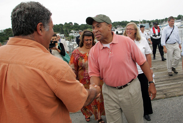loucester: Governor Deval Patrick greets Vito Giacalone, a fisheries advocate, after arriving to the Jodrey State Fish Pier by boat Wednesday afternoon.  Patrick toured the Whole Foods plant on Parker Street before going over to Cruiseport to talk with Seafood Coalition leaders and with local fishermen. Mary Muckenhoupt/Gloucester Daily Times