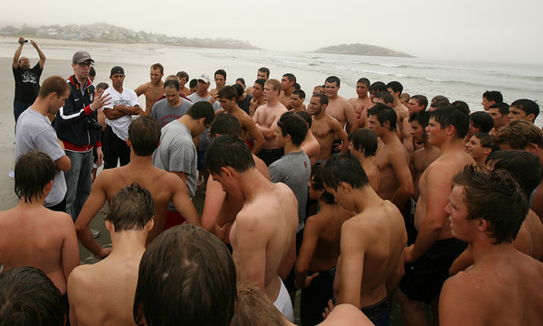 Gloucester: Scott Barboza of ESPN Boston speaks with local athletes following a session of Mike Lattof's conditioning clinic at Good Harbor Beach yesterday morning. ESPN Boston will begin covering high school sports on their website in August and the clinic will be the first feature story. Photo by Kate Glass/Gloucester Daily Times