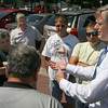 Gloucester: Charlie Baker, republican candidate for governor, speaks with a group of Gloucester fishermen at St. Peter's Square about how the regulations are forcing them out of work. Photo by Kate Glass/Gloucester Daily Times