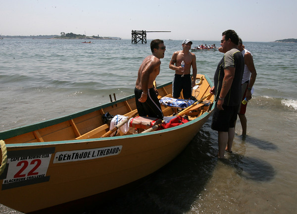 Gloucester: Joe Sanfilippo and Jeff Muise are greeted by Russell Atkinson and Fenton Cunningham of Nova Scotia, who were the first dory boat to finish the Blackburn Challenge, a 20-mile open water race around Cape Ann, Saturday morning. Sanfilippo and Muise finished second. Photo by Kate Glass/Gloucester Daily Times