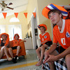 Rockport: Shaffy Roell, 17, a soccer player at Rockport High School, watches the Germany vs. Spain world cup soccer game with his family, including his mom Saskia, left, and brothers Sam and Gideon in their Rockport home Wednesday afternoon. The Roells, who are from the Netherlands, were waiting to see who would win this game because the winner plays the Netherlands on Sunday. Mary Muckenhoupt/Gloucester Daily Times
