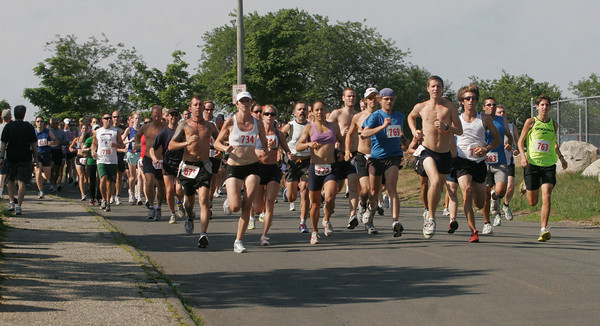 Gloucester: Roughly 200 runners make their way down the hill at the start of the Seventh Annual Seacoast 7 Road Race at Stage Fort Park on Saturday morning. Photo by Kate Glass/Gloucester Daily Times