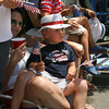Manchester: Charlie Swanson, front, and Wesley Card sit in the laps of their mothers, Karen Swanson and Aime Card, to watch the Manchester 4th of July Parade yesterday afternoon. Photo by Kate Glass/Gloucester Daily Times
