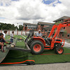 Manchester: Crews from Statewide Construction work to unrolling a section of the turf field in front of Manchester Essex Regional High School Thursday morning.  The field is rolled out in sections and then sewn together. Mary Muckenhoupt/Gloucester Daily Times