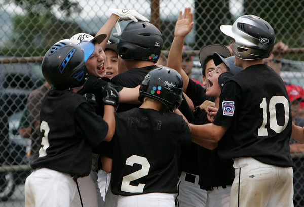 Gloucester: Teammates cheer for Beverly's Gavin Sparkman after he hit a two run double during the District 15 Little League all-star baseball game against Amesbury at Stage Fort Park in Gloucester. Sparkman had hit a home run but didn't touch third base so his run didn't count. Mary Muckenhoupt/Gloucester Daily Times