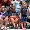 Manchester: Grace Goodell, Ben Goodell, and Nora Goodell wave flags during the Manchester 4th of July Parade yesterday afternoon. Photo by Kate Glass/Gloucester Daily Times