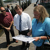 Gloucester: Mayory Caroline Kirk shows Lt. Gov. Tim Murray plans for the proposed Harbor Walk before taking a boat tour of Gloucester harbor at Harbor Loop Thursday afternoon.  Standing left is city councilor Greg Verga.  Mary Muckenhoupt/Gloucester Daily Times