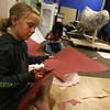 Gloucester: Amelia Zenkin makes a krill hat at Cape Ann Art Haven during the Young Artist's Workshop. The class created a giant whale out of paper mache for the Whale Fest this weekend. Photo by Kate Glass/Gloucester Daily Times