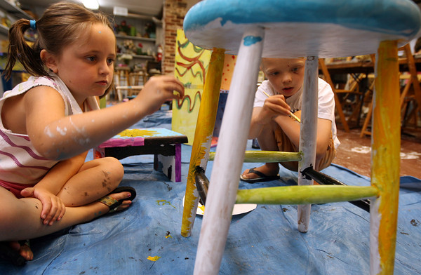 "Rockport: Molly Timmons, 7, of Rockport helps Ethan Anderson, 7, of Gloucester paint a stool during a furniture painting class at the Rockport Art Association. Timmons says, ""We've known each other since we were babies. We help each other a lot."" Photo by Kate Glass/Gloucester Daily Times"