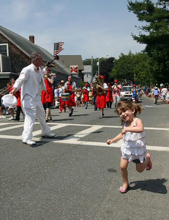 Sylvia McCavanagh, 4, who recently moved to Manchester, dances along with the Tony Barrie Band during the Manchester 4th of July Parade yesterday morning. Photo by Kate Glass/Gloucester Daily Times