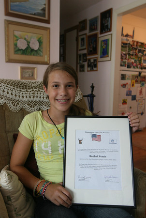 "Rachel Nearis, a 12-year-old O'Maley Middle School student, recently won a national essay contest sponsored by the Elks. Her essay, written about the theme, ""Why I am proud to be an American,"" was selected out of 55,000 submissions. Photo by Kate Glass/Gloucester Daily Times"