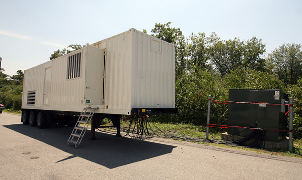 National Grid brought in large generators to help get businesses in the Blackburn Industrial Park up and running following a power outage that began Thursday afternoon. Photo by Kate Glass/Gloucester Daily Times