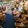 "Emily Stanton reads ""The Princess Who Had Almost Everything"" to a group of children from the Magic Years Summer Adventure group at the Manchester Library during the ""One World, Many Stories"" event. Photo by Maria Uminski/Gloucester Daily Times"