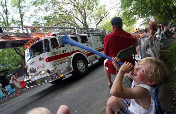 Deston Cauthers, 6, of Gloucester tries to make more noise than the fire engines while watching the Rockport Firemen's Association Fourth of July Parade last night. Photo by Kate Glass/Gloucester Daily Times