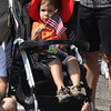 Ryan Ellington, 2, waves a flag as he watches the start of the Manchester 4th of July Parade yesterday morning. Photo by Kate Glass/Gloucester Daily Times