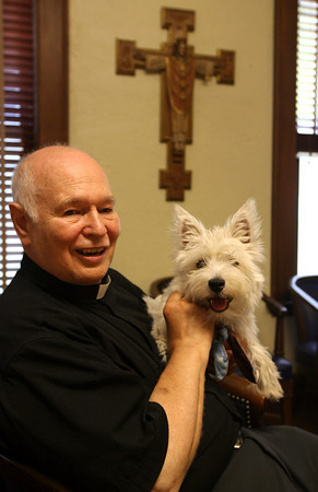 Gloucester: The Rev. Ronald J. Gariboldi will be celebrating his last mass at St. Ann Church this Sunday. He is retiring, with his dog, Tom, after 50 years with the parish. Photo by Kate Glass/Gloucester Daily Times