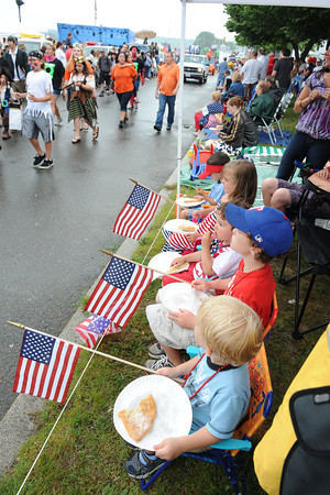 Gloucester: Oliver Copland 3,Connor Oliveira 3,Carson Harwood 7, Joie Grace Cody 5, and Jackson Cody 3, eat fried dough as they all watch the Horribles Parade Sunday afternoon on Western Ave. Desi Smith/Gloucester Daily Times. July3,2011