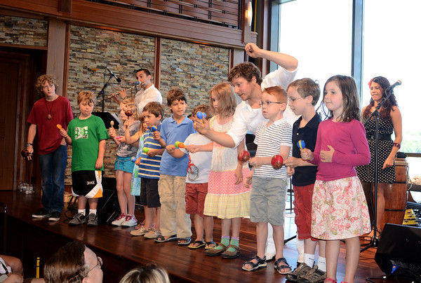 Rockport: Kenny Kozol of the band Ten Tumbao brought some kids up on stage for their last piece and shows them how to shake their maracas, Saturday morning at the Shalin Liu Theater. Desi Smith/Gloucester Daily Times July 16, 2011.