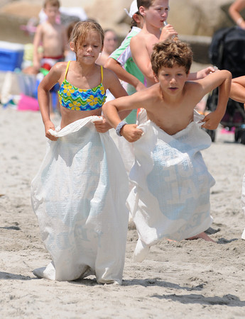 Rockport: Emmi Triplett 10, and Toby Campbell 9, compete in the sack race, run by James and Leigh Keenan at the Old Garden Beach Association's Annual Children's Picnic Staurday afternoon. Desi Smith/Gloucester Daily Times. July 23,2011