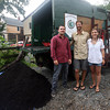 Justin Sandler, Conor Miller, and Sarah Wolfskehl of Black Earth Hauler stand outside their truck, which they use to pick up food waste materials and drop off compost. Photo by Kate Glass/Gloucester Daily Times